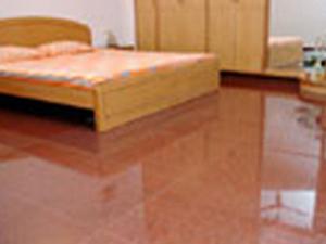 Granite Flooring in a Bedroom